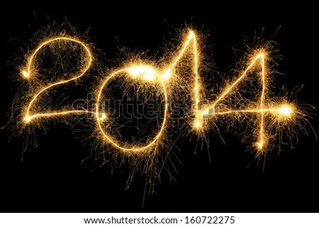 New Year 2014 formed from sparking digits over black background - stock photo