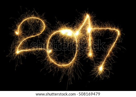 New Year 2017 formed from sparking digits over black background