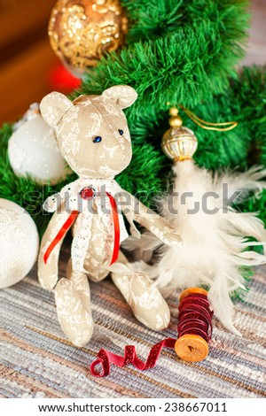 New year gift - handmade tilda Teddy bear toy on christmas background. Indoors still-life. - stock photo
