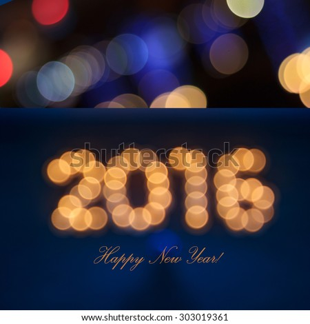 new year greeting card made of colorful bokeh digits in shape of 2016 on blue background with copy space - stock photo