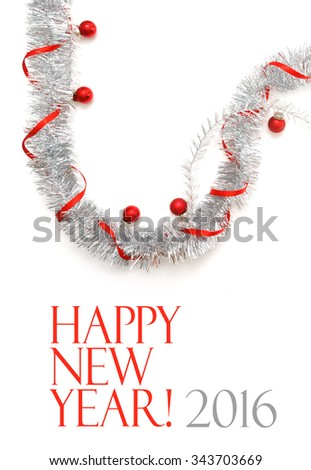 New Year greeting card made of silver tinsel with red christmas balls and red ribbon - stock photo