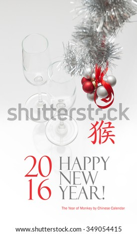 New Year greeting card template made of two champagne glasses with red and silver balls hanging on red ribbon and silver tinsel, chinese hieroglyph for monkey - stock photo