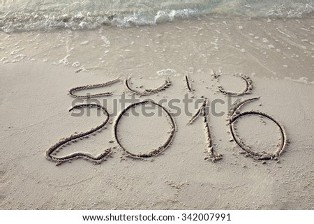 New Year 2016 is coming concept. Happy New Year 2016 replace 2015 concept on the sea beach - stock photo