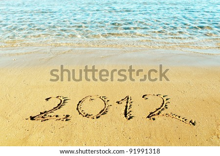"New Year is coming concept - the inscription ""2012"" on a beach sand - stock photo"