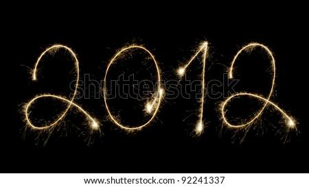 New year 2012 isolated on black background - stock photo