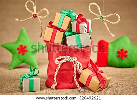New Year 2016. Merry Christmas, Santa Claus red sack of presents, green star, handmade. Party decoration, gift boxes. Cheerful happy winter holiday. Vivid greeting card, multicolored, copyspace - stock photo