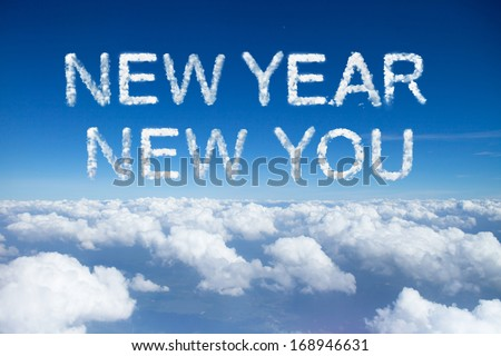 new year new you clouds word on sky over clouds. - stock photo