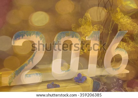 New Year 2016 on a beautiful background bokeh background abstract.