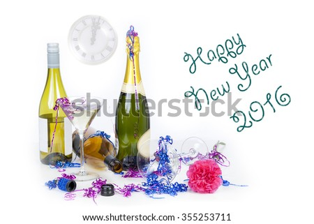 New year 2016 party table with champagne, glasses and streamers with a clock showing past midnight on a pure white backgroung - stock photo