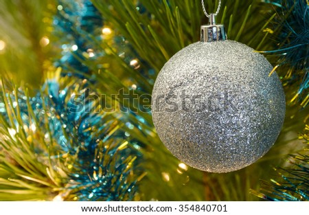 New Year pine-tree and decorations. Background for Christmas sales & discounts (selective focus)