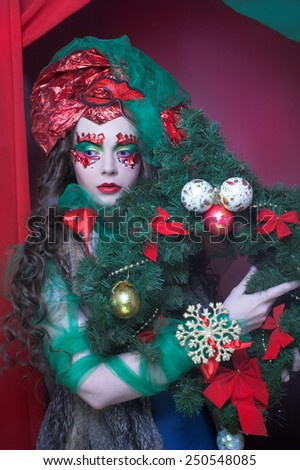 New Year. Portrait of young woman in artistic holiday image. - stock photo