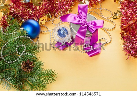 New Year present and decorations on yellow background - stock photo