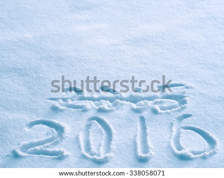 New Year 2016 replace 2015 concept on blue snow surface