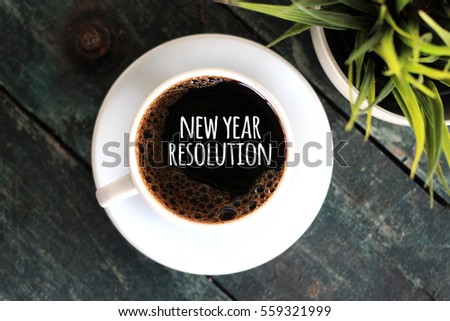 NEW YEAR RESOLUTION - coffee cup concept on wooden background
