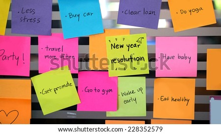 new year resolutions post it concept - stock photo
