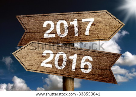 New year 2017 road sign with cloudy sky background. - stock photo