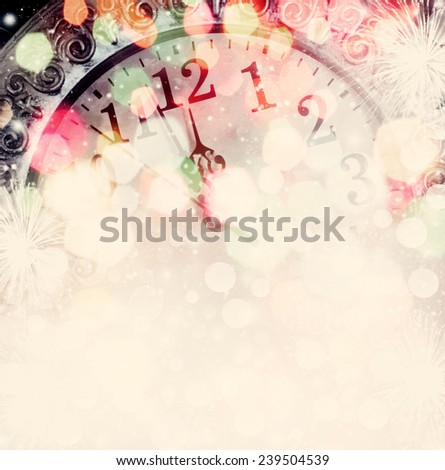 New Year's at midnight - clock on bokeh background - stock photo