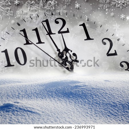 New Year's at midnight - old clock in snow - stock photo
