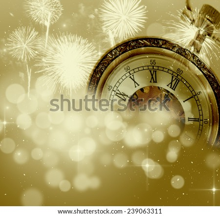 New Year's at midnight - old clock in snow on colorful bokeh background  - stock photo