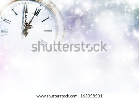New Year's at midnight - Old golden clock with stars and snowflakes - stock photo