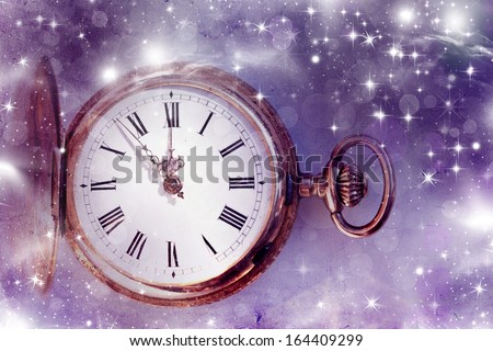 New Year's at midnight - Vintage photo of old clock with stars and snowflakes