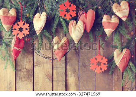 New Year's background. A background with branches of a fir-tree and New Year's toys in the form of hearts. For a New Year's or Christmas greeting card or a fragment of a New Year's collage. - stock photo