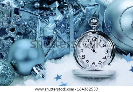 New Year's Background. pocket watch and Christmas decorations.  - stock photo