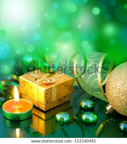 New Year's card with green balls and a streamer - stock photo