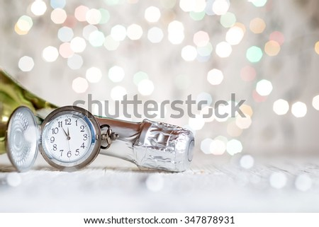 New Year's clock and champagne at midnight - stock photo