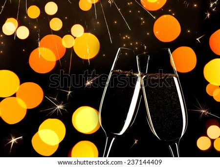 New Year's concept.   Celebration on New Year's Eve.   Close up of two glasses of Champagne clinking together. - stock photo