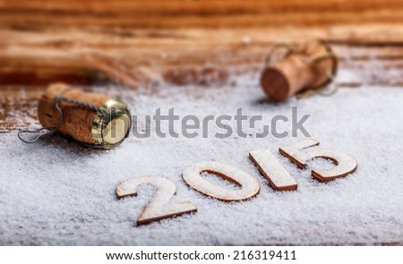 New Year's concept, Champagne cork and 2015 made of wood - stock photo