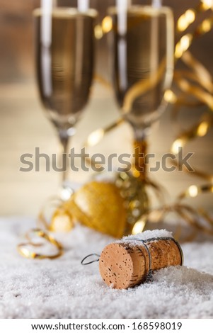 New Year's concept with champagne cork and glasses - stock photo