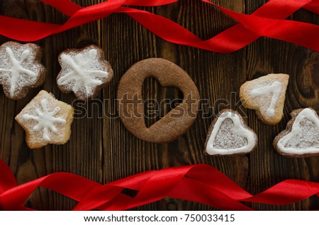 New Year's cookies and red tape on the brown wooden table