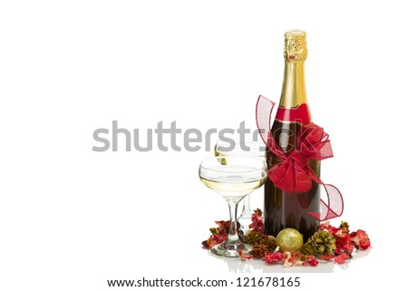 New Year's Day - champagne bottle, two glasses and decoration over white background with copy space. - stock photo