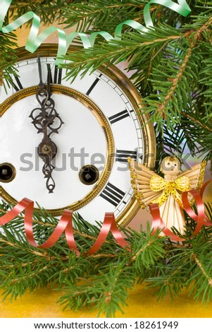 New Year's decoration with an antique clock and a firtree branch