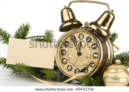New Year's decoration with an antique clock and a firtree branch and a blank card for your text