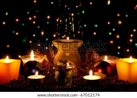 New Year's decorations and candles on the background lights