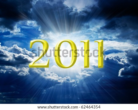 New Year's Eve against the dark sky and the sun's rays make their way through the dark clouds - stock photo