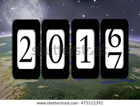 New Year's Eve 2017 black odometer on outer space background with moon