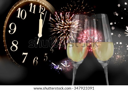 New Year's Eve - sparkling wine glasses and fireworks - stock photo
