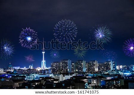 new year's eve with fireworks in berlin - stock photo