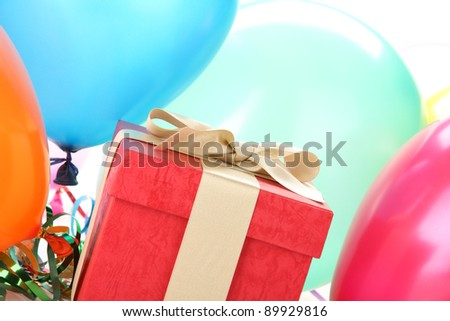 New Year's gift with balloons. - stock photo