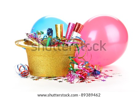 New Year's hat filled with noise makers, streamers and balloons on white background. - stock photo