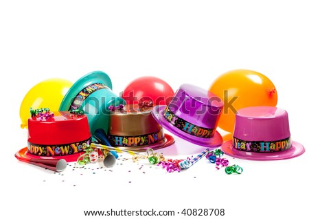 New Year's hats, noise makers, streamers, balloons and confetti on a white background - stock photo