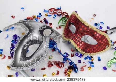 New Year's Masked Party with Grey and Red Masks - stock photo