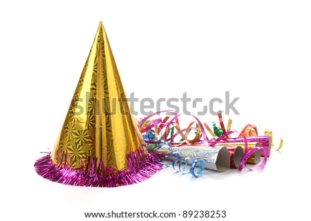 New Year's party hat and noisemaker with streamers - stock photo