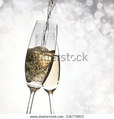 New Year's - toasting with champagne glasses against fireworks and holiday lights - stock photo