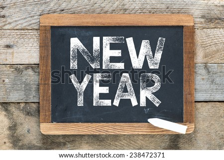 New year sign. New year sign on chalkboard - stock photo