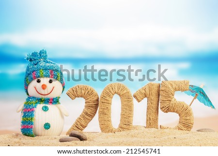 New year 2015 sign with snowman on beach background - stock photo