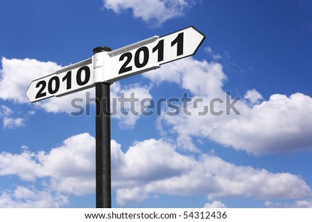 New year signpost for the years 2010 and 2011 - stock photo